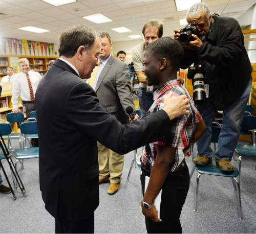 Steve Griffin     The Salt Lake Tribune  Gov. Gary Herbert talks with Granite Park Jr. High School ninth-grader Omar Hussein about his plans for school and his career following Herbert announcing his fiscal year 2016 budget proposal in Salt Lake City, Thursday, December 11, 2014.