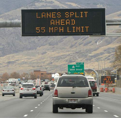 Al Hartmann     The Salt Lake Tribune Four lanes of traffic along I-15 northbound near Woods Cross are warned of the upcoming traffic split ahead for a freeway construction project.