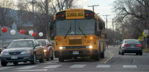 Al Hartmann     The Salt Lake Tribune               A school bus at the intersection of 3300 South and 2100 East in Salt Lake City. Gov. Gary  Herbert on Thursday, Dec. 11, 2014, unveiled his budget and called for $20 million to replace old, dirty school buses.