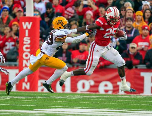 FILE - In this Nov. 29, 2014, file photo, Wisconsin's Melvin Gordon (25) runs against Minnesota's Brien Boddy-Calhoun during the first half of an NCAA college football game  in Madison, Wis. No. 11 Wisconsin coach Gary Andersen said Melvin Gordon's right ankle is fine, though he will be keeping close tabs on his star running back as the Badgers prepare for the Big Ten title game against Ohio State. (AP Photo/Andy Manis, File)