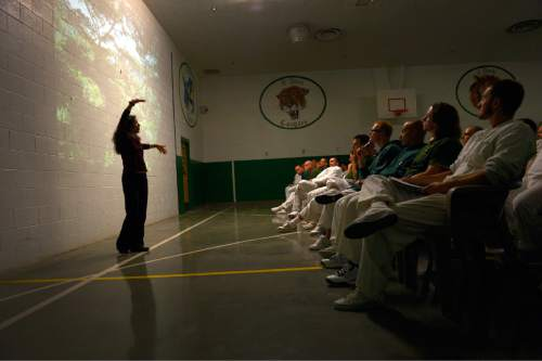 "Leah Hogsten  |  The Salt Lake Tribune ""I love trees,"" said Nalini Nadkarni who kept inmates intrigued with her animated lecture.  University of Utah science professor and forest ecologist, Nalini Nadkarni, brought the forest to inmates of the Promontory facility at the Utah State Prison to get the men interested in careers in forest science such as arboriculture and landscaping. The lecture series is modeled after a Washington state program co-founded by the Nadkarni in 2005 and other upcoming lectures will center around biology, ecology, chemistry, physics and math."