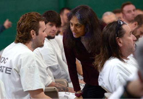 Leah Hogsten  |  The Salt Lake Tribune University of Utah science professor and forest ecologist, Nalini Nadkarni, listens as inmates ask her about their curiosities about trees and their observations. Nadkarni brought the forest to inmates of the Promontory facility at the Utah State Prison to get the men interested in careers in forest science such as arboriculture and landscaping. The lecture series is modeled after a Washington state program co-founded by the Nadkarni in 2005 and other upcoming lectures will center around biology, ecology, chemistry, physics and math.