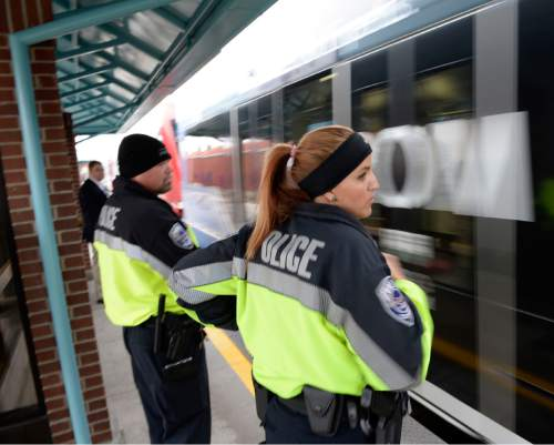Al Hartmann  |  The Salt Lake Tribune UTA police officers Steve Rowland and Aymee Race wait at station platform to hop on a TRAX train for a check to see if riders have purchased tickets.