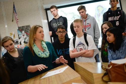 Francisco Kjolseth  |  The Salt Lake Tribune Bountiful High Visual Arts teacher Sunny Magee, second from left, describes a new assignment to students on Friday, Dec. 12, 2014. New statewide graduation numbers were released on Friday and Bountiful High School has among the highest graduation rates in Utah.