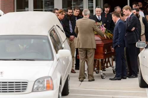 Trent Nelson     The Salt Lake Tribune Pallbearers gather at the conclusion of Poet Emma Lou Thayne's funeral in Salt Lake City, Friday December 12, 2014.
