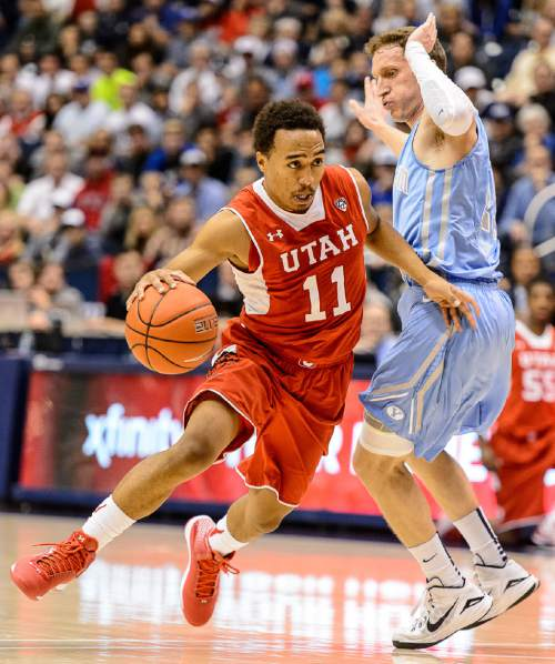 Trent Nelson  |  The Salt Lake Tribune Utah Utes guard Brandon Taylor (11) drives around Brigham Young Cougars guard Skyler Halford (23) as BYU hosts Utah, college basketball at the Marriott Center in Provo, Wednesday December 10, 2014.