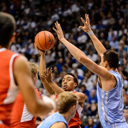 Trent Nelson     The Salt Lake Tribune Utah Utes guard Brandon Taylor (11) looks to pass as BYU hosts Utah, college basketball at the Marriott Center in Provo, Wednesday December 10, 2014.