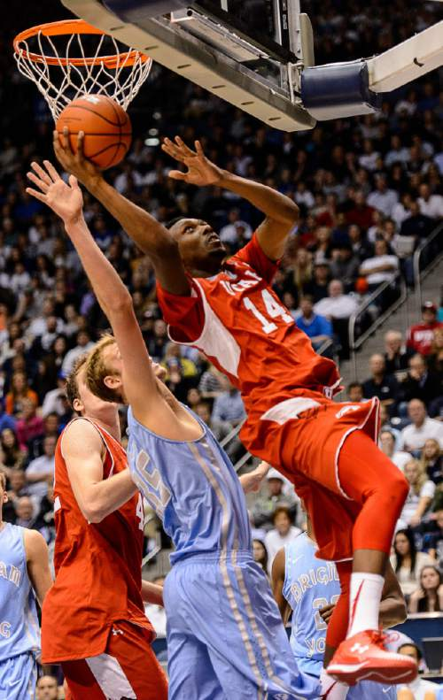 Trent Nelson  |  The Salt Lake Tribune Utah Utes guard/forward Dakarai Tucker (14) puts up a shot, defended by Brigham Young Cougars forward Isaac Neilson (35) as BYU hosts Utah, college basketball at the Marriott Center in Provo, Wednesday December 10, 2014.