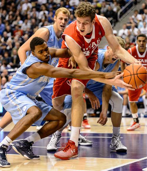 Trent Nelson  |  The Salt Lake Tribune Utah Utes forward Jakob Poeltl (42) is defended by Brigham Young Cougars guard Anson Winder (20), as BYU hosts Utah, college basketball at the Marriott Center in Provo, Wednesday December 10, 2014.