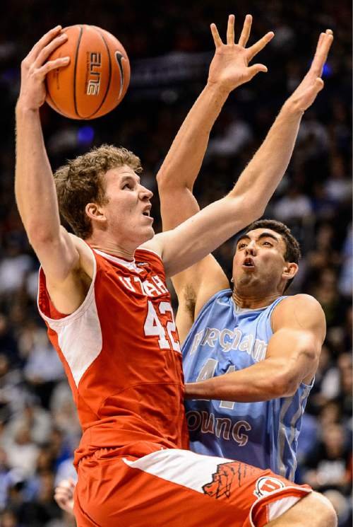 Trent Nelson  |  The Salt Lake Tribune Utah Utes forward Jakob Poeltl (42) goes to the basket, defended by Brigham Young Cougars center Corbin Kaufusi (44) as BYU hosts Utah, college basketball at the Marriott Center in Provo, Wednesday December 10, 2014.