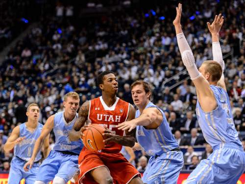 Trent Nelson  |  The Salt Lake Tribune Utah Utes guard Delon Wright (55) faces a group of BYU defenders as BYU hosts Utah, college basketball at the Marriott Center in Provo, Wednesday December 10, 2014.