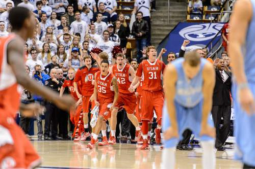 Trent Nelson  |  The Salt Lake Tribune Utah players celebrate the win as BYU hosts Utah, college basketball at the Marriott Center in Provo, Wednesday December 10, 2014.