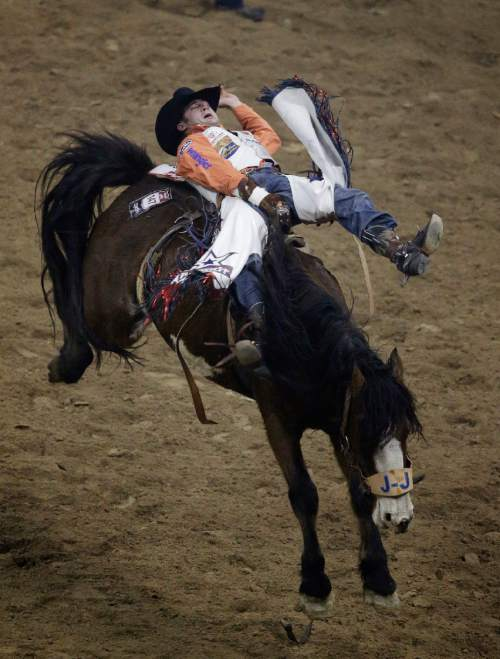 Bareback rider Kaycee Feild from Spanish Fork, Utah, competes during the ninth go-round of the National Finals Rodeo Friday, Dec. 12, 2014, in Las Vegas. (AP Photo/John Locher)
