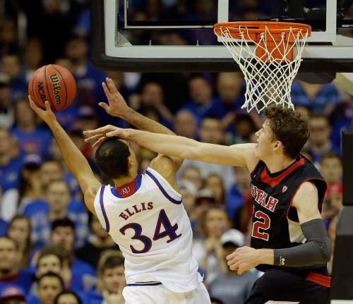 Kansas' Perry Ellis (34) is fouled by Utah's Jakob Poeltl during the second half of an NCAA college basketball game Saturday, Dec. 13, 2014, in Kansas City, Mo. Kansas won 63-60.  (AP Photo/Charlie Riedel)