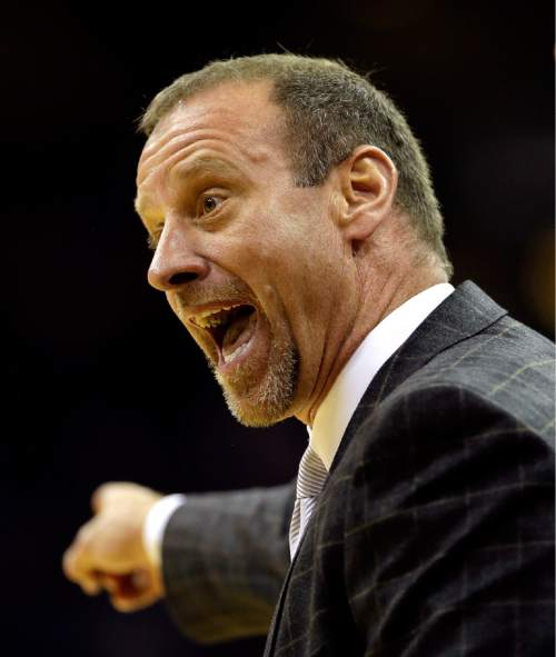 Utah coach Larry Krystkowiak argues a call during the second half of an NCAA college basketball game against Kansas, Saturday, Dec. 13, 2014, in Kansas City, Mo. Kansas won 63-60.  (AP Photo/Charlie Riedel)