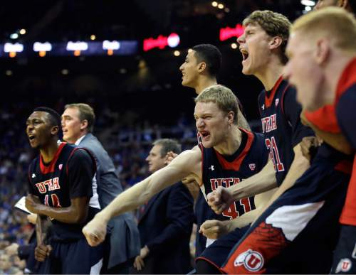 The Utah bench celebrates a teammate's basket during the second half of an NCAA college basketball game against Kansas Saturday, Dec. 13, 2014, in Kansas City, Mo. Kansas won 63-60.  (AP Photo/Charlie Riedel)