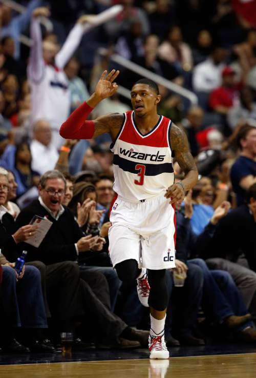 Washington Wizards guard Bradley Beal (3) celebrates his three-point shot in the first half of an NBA basketball game against the Los Angeles Clippers, Friday, Dec. 12, 2014, in Washington. (AP Photo/Alex Brandon)