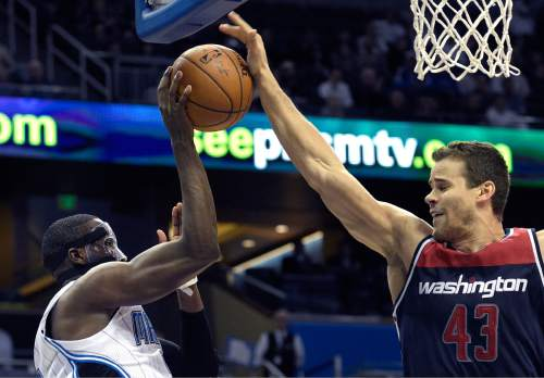 Washington Wizards forward Kris Humphries (43) blocks a pass by Orlando Magic guard Victor Oladipo, left, during the second half of an NBA basketball game in Orlando, Fla., Wednesday, Dec. 10, 2014. The Wizards won 91-89. (AP Photo/Phelan M. Ebenhack)