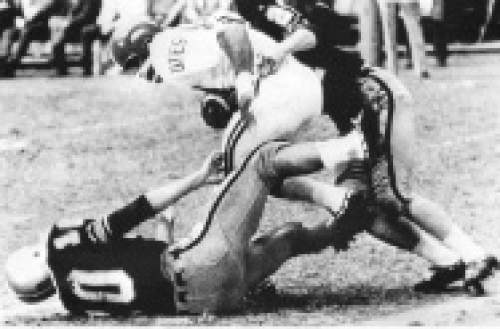 Courtesy  |  Utah Athletics  An unidentified Utah player is brought to the ground at the 1964 Liberty Bowl, which Utah won 32-6 against West Virginia, amassing 323 rushing yards.