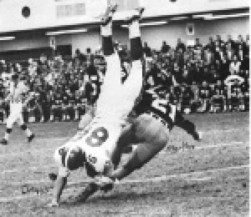 Courtesy  |  Utah Athletics  West Virginia's Richie Martha tackles Utah's Utah's Merlin Driggs onto the 2-inch thick sod at Atlantic City Convention Hall during the 1964 Liberty Bowl.
