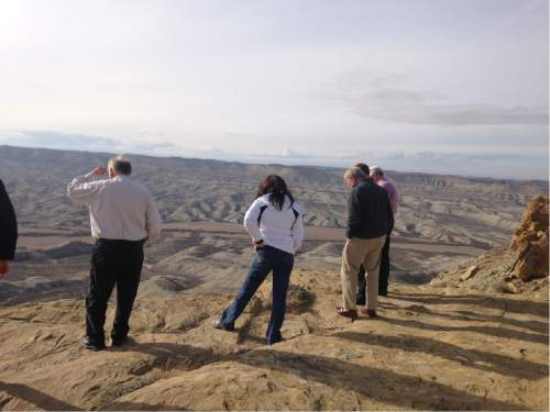 Lee Davidson  |  The Salt Lake Tribune   A tour of legislators and staff look at overview near new Seep Ridge Road in Uintah County. Officials hope road could be part of highway directly connecting western national parks. Environmentalists say the parks-highway plan is a ruse to benefit the oil and gas industry.