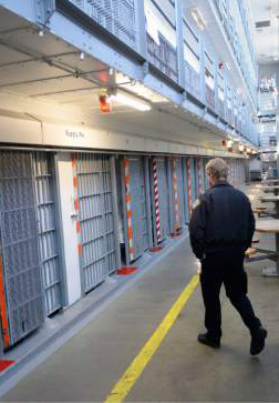 Al Hartmann     Tribune file photo  Utah Department of Corrections officer walks through the medium security Wasatch A block at the Utah State Prison in Draper. West Jordan looks like it's off the list of relocation sites, which has been narrowed down to four sites.