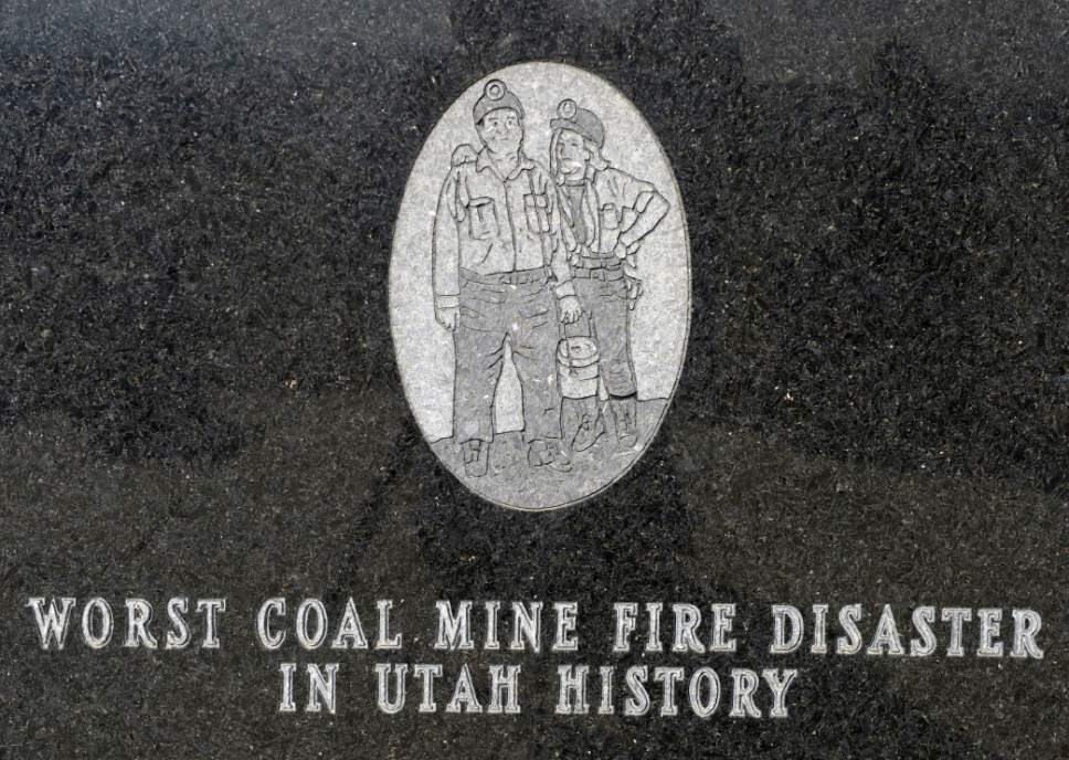 Al Hartmann  |  The Salt Lake Tribune Detail from the United Miner Workers' monument to the 27 coal miners who died in the Dec. 19, 1984 Wilberg Mine firer, the state's worst disaster of the past 90 years. The monument is on the road from the Emery County town of Orangeville to the mine, which was in the distant hills.