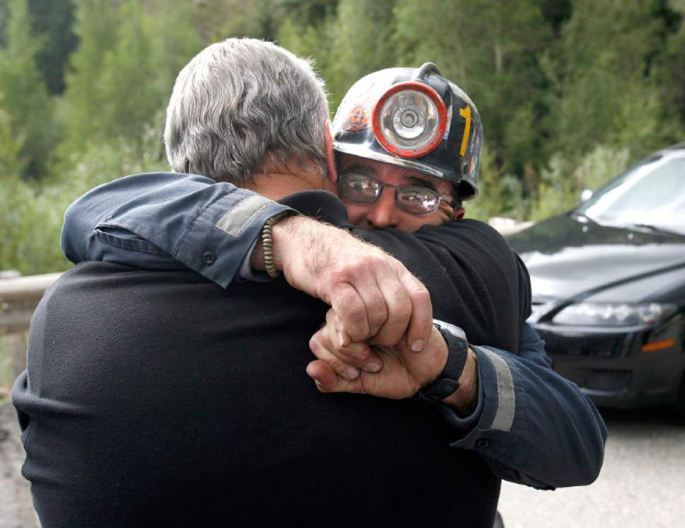 "Al Hartmann  |  Tribune File Photo  ""It gave me a lot more compassion,"" said former Emery County Sheriff Lamar Guymon of his experiences at Wilberg, seen here during the 2007 Crandall Canyon mine disaster giving a hug to miner Bodee Allred after Allred was paraded before the news media to describe efforts to dig back to a six-man mining crew buried by a massive implosion of the mine walls."