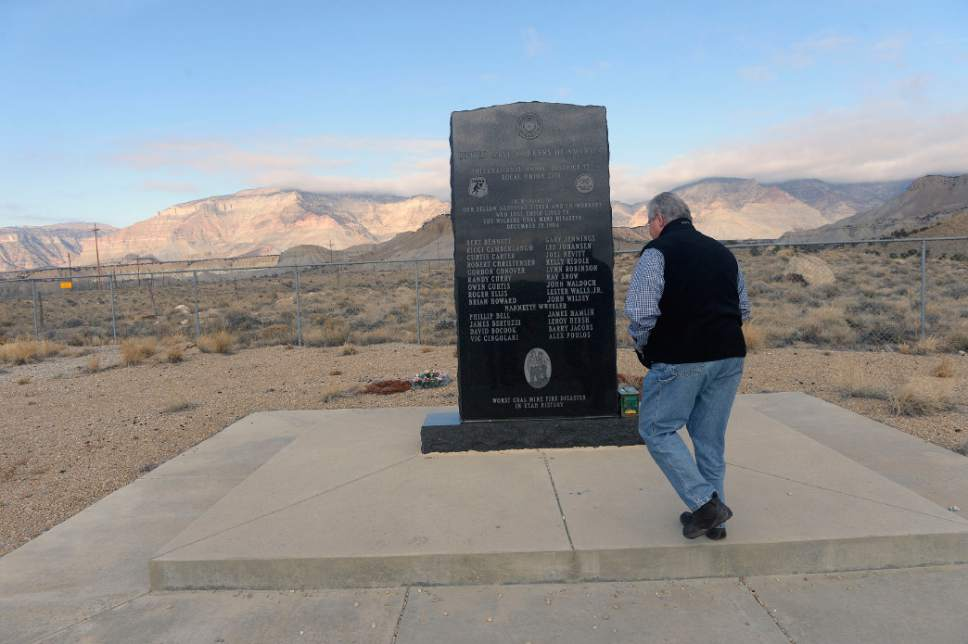 Al Hartmann  |  The Salt Lake Tribune Former Emery County Sheriff Lamar Guymon visits the United Mine Workers' monument to the 27 coal miners who died in the Dec. 19, 1984 fire at the Wilberg Mine, the state's worst disaster of the past 90 years.  The monument is along the road from Orangeville to the mine in the distant Wasatch Plateau.