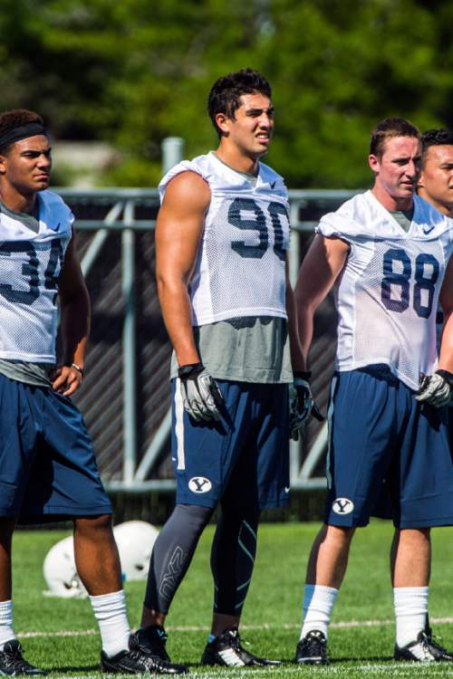 Chris Detrick  |  The Salt Lake Tribune Brigham Young Cougars linebacker Bronson Kaufusi (90) during a practice at Richards Building Fields Friday August 1, 2014.