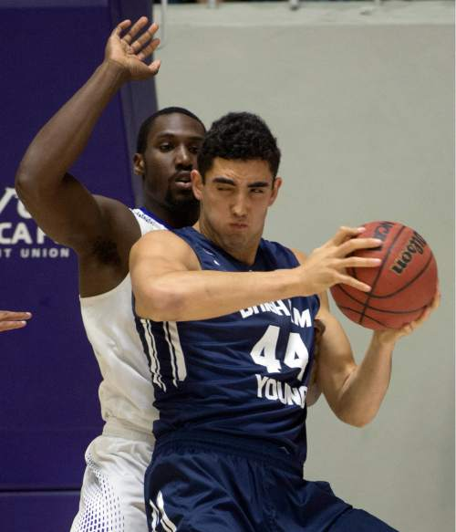 Rick Egan  |  The Salt Lake Tribune  Brigham Young Cougars center Corbin Kaufusi (44) works on Weber State Wildcats forward Jaylen Johnson-Coston (2), in basketball action BYU vs Weber State, at the Dee Events Center in Ogden, Saturday, December 13, 2014