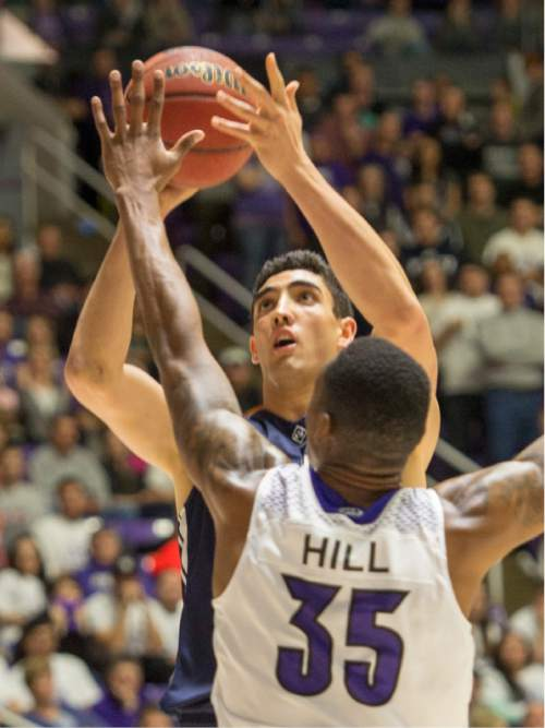 Rick Egan  |  The Salt Lake Tribune  Brigham Young Cougars center Corbin Kaufusi (44) shoots over Weber State Wildcats forward Kyndahl Hill (35), in basketball action BYU vs Weber State, at the Dee Events Center in Ogden, Saturday, December 13, 2014