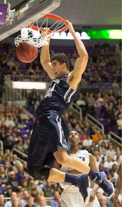 Rick Egan  |  The Salt Lake Tribune  Brigham Young Cougars center Corbin Kaufusi (44) dunks the ball, in basketball action BYU vs Weber State, at the Dee Events Center in Ogden, Saturday, December 13, 2014