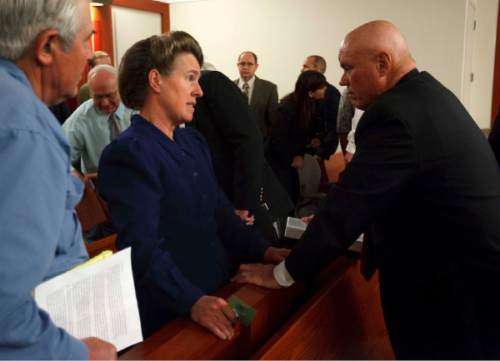 Salt Lake City - FLDS member Mary Harker (left) speaks with Bruce Wisan following a hearing held at the Matheson Courthouse Wednesday, July 29, 2009 to decide on the sale of the Berry Knoll property in the United Effort Plan (UEP) land trust. Pool/Trent Nelson/The Salt Lake Tribune; 7.29.2009