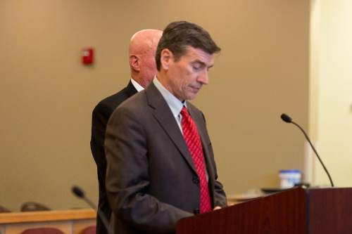 Trent Nelson     The Salt Lake Tribune Bruce Wisan deliberately stands behind his attorney Greg Skordas (in red tie) during his appearance in a Taylorsville court room on a charge of contempt of court and a misdemeanor count of soliciting a prostitute, Thursday October 9, 2014.