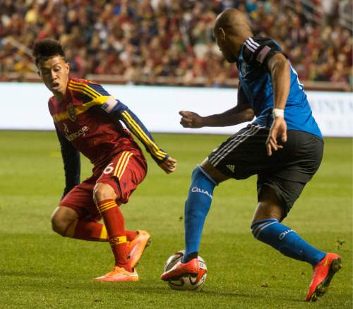Rick Egan  |  The Salt Lake Tribune  Sebastian Velasquez (26) goes for the ball along with San Jose Earthquakes forward Alan Gordon (16), in RSL action Real Salt Lake vs. San Jose Earthquakes, at Rio Tinto Stadium, Saturday, October 11, 2014