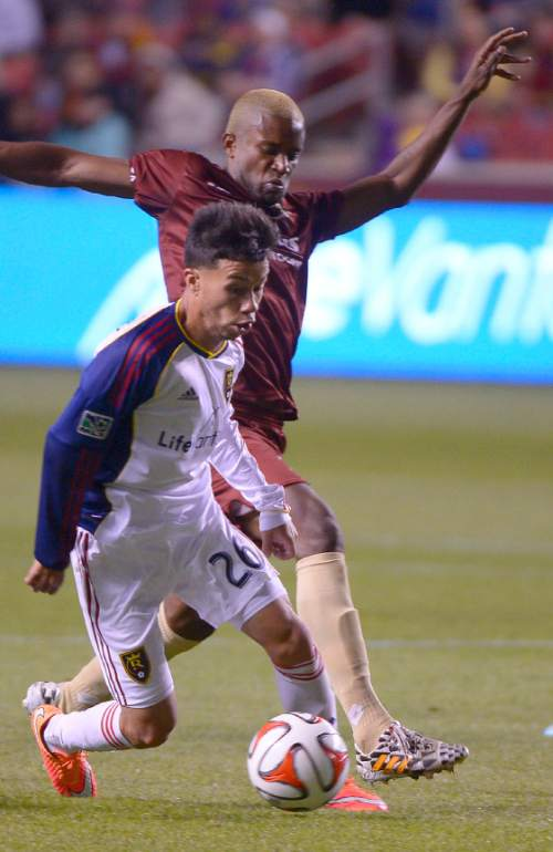 Leah Hogsten  |  The Salt Lake Tribune Sacramento Republic FC midfielder Gilberto Souza (7) tries to round Real Salt Lake midfielder Sebastian Velasquez (26). Real Salt Lake hosted Sacramento Republic during their exhibition game Tuesday, September 30, 2014.