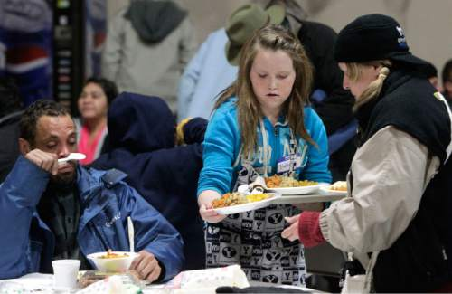 Leah Hogsten     Tribune file photo Stahlie Singleton, 12 at the time of this photo last Christmas, serves dinners to the needy with her family at the Salt Lake City Rescue Mission.