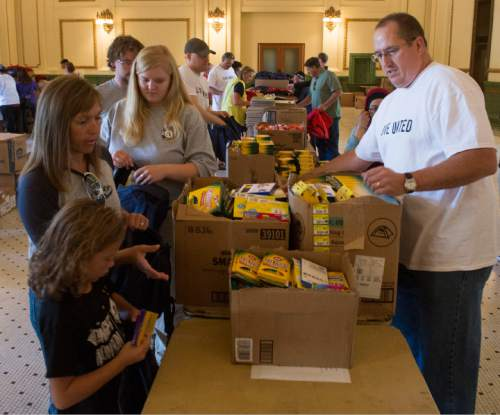 Rick Egan     The Salt Lake Tribune  Volunteers help fill 8,500 backpacks with school supplies for low-income kids in the Grand Hall at the Gateway, during United Way of Salt Lake's 22nd annual Day of Caring, Thursday, September 11, 2014.  More than 5,500 volunteers from over 125 companies participated in 130 service projects throughout  Davis, Salt Lake, Summit and Tooele counties today.