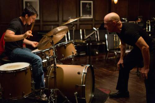 """Young drummer Andrew (Miles Teller, left) is pushed to the limit by his profane teacher, Terence Fletcher (J.K. Simmons), in the drama """"Whiplash."""" Courtesy Sony Pictures Classics"""