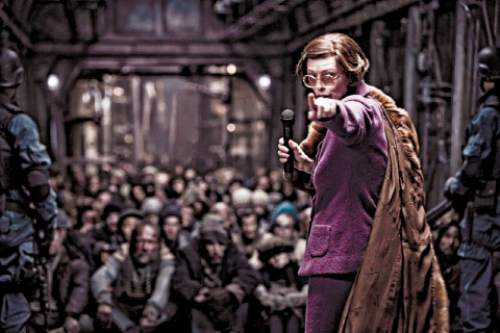 """The Minister (Tilda Swinton) maintains order over the residents of the tail section of a train carrying what's left of humanity, in the action thriller """"Snowpiercer."""" Courtesy Radius TWC"""