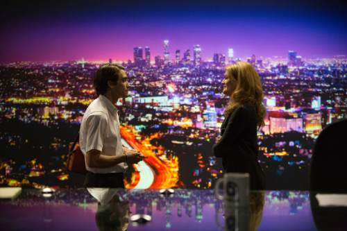 """In this image released by Open Road Films, Jake Gyllenhaal, left, and Rene Russo appear in a scene from the film, """"Nightcrawler."""" (AP Photo/Open Road Films, Chuck Zlotnick)"""