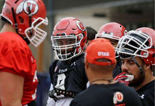 Utah's Nate Orchard, second from left, practices with his team Wednesday, Dec. 17, 2014, in Las Vegas. Utah is scheduled to play Colorado State in the Las Vegas Bowl NCAA college football game Saturday. (AP Photo/John Locher)