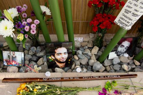Trent Nelson     The Salt Lake Tribune Photos, notes, flowers and a wooden sword at a memorial to Darrien Hunt Sunday September 14, 2014 at the Saratoga Springs Panda Express, where Hunt was shot and killed by police.