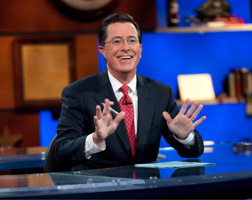 "This Sept. 8, 2010 publicity photo released by Comedy Central shows host Stephen Colbert appears on ""The Colbert Report,"" in New York.  ""The Colbert Report"" will end on Thursday, Dec. 18, 2014, after nine seasons. (AP Photo/Comedy Central, Scott Gries)"