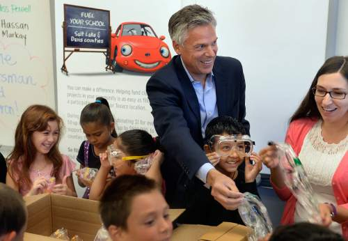 Scott Sommerdorf   |  The Salt Lake Tribune Jon M. Huntsman, Jr.distributes the contents of a science-related box of teaching materials to Melody Francis' 4th grade classroom at Rose Park Elementary in association with Chevron's 2014 Fuel Your School Program, Wednesday, september 3, 2014. Huntsman has been U.S. Ambassador to China and Utah's Governor and is currently a Chevron Board of Directors Member. In front of Ambassador Hunstman is Hassan Hamid, 9, trying on laboratory goggles. Natalie Richards, 9, is at far left.