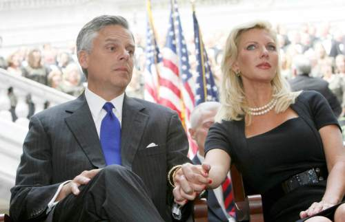 (Tribune file photo)  Jon Huntsman holds the hand of his wife Mary Kaye during Gary Herbert's inauguration as Utah's new governor Aug. 11, 2009,  at the Utah State Capitol in Salt Lake City.  (Keith Johnson, POOL)