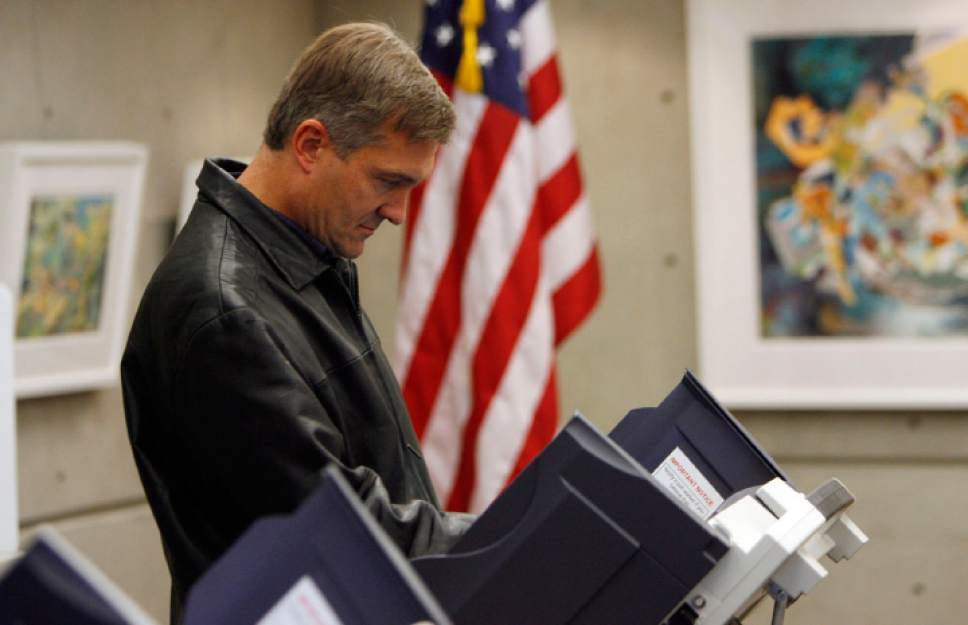 Francisco Kjolseth  |  Tribune file photo Rep. Jim Matheson casts his vote for himself in the 2010 election. He was forced by liberal Democrats into a primary that year against Claudia Wright, then had one of his closest elections in several years against Republican Morgan Philpot.