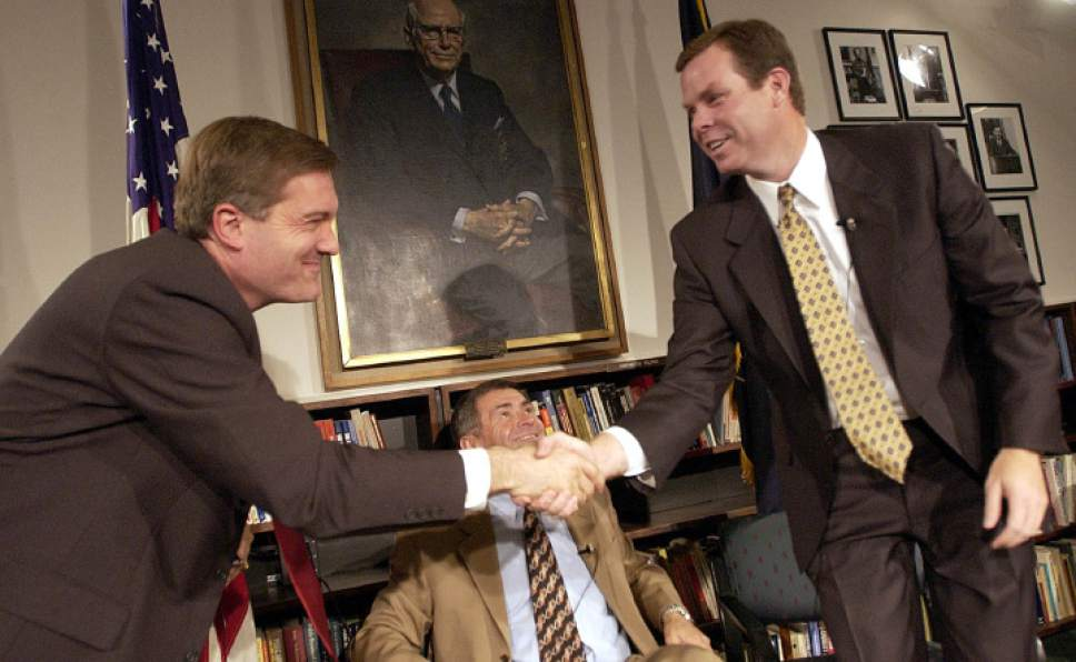 Francisco Kjolseth  |  Tribune file photo Democratic Rep. Jim Matheson, left, and Republican John Swallow shake hands following a spirited debate in the 2002 election. It was Matheson's closest race -- until his election brawl with Mia Love in 2012. In both elections, the margin of victory for Matheson was less than one percent.