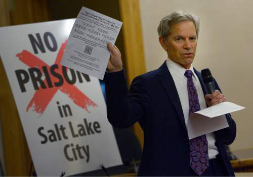 "Leah Hogsten  |  The Salt Lake Tribune Mayor Ralph Becker holds a handout to attendees outlining the ""Top Five Ways to Help Keep the Prison out of Salt Lake City."" Salt Lake City residents express their concerns about the prison relocation to Mayor Ralph Becker and other legislators, Tuesday, December 16, 2014 at the City and County Building."